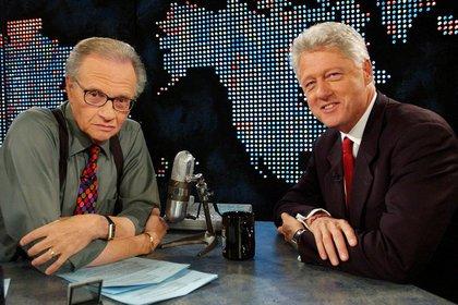 Con Bill Clinton, ya ex presidente, el 3 de septiembre de 2002